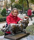 Olga petting the cat statue